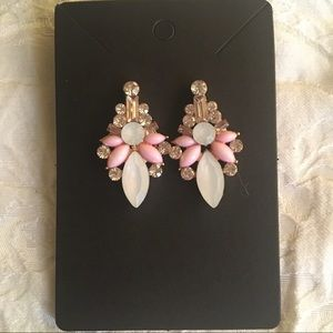 Pink and white statement earrings.